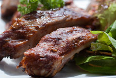 BBQ Pork Spare Ribs with french fries and salad Royalty Free Stock Photos