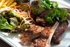 BBQ Pork Spare Ribs with french fries and salad Royalty Free Stock Image