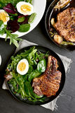 Bbq pork steak. With green salad, top view stock images