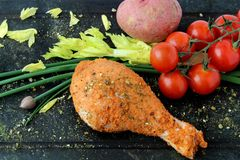 BBQ raw chicken drumstick ready to cook. With vegetables Stock Photo