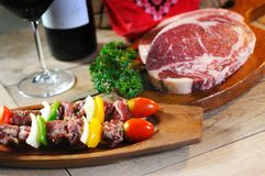 BBQ with raw meat. And wine Stock Photos