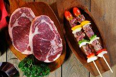 Bbq and raw meat Royalty Free Stock Photo