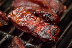 Bbq ribs. Barbecue beef spare ribs cooking on a grill outdoors in summer royalty free stock images