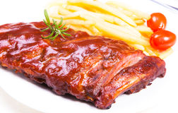 BBQ ribs. Close up BBQ ribs with fries stock image