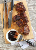 BBQ ribs. On a kitchen wooden board royalty free stock photo