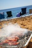 BBQ Ribs. Delicious ribs on grill. Picnic on the beach royalty free stock photos