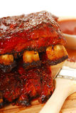 BBQ Ribs. Two slabs of BBQ spare ribs with dipping sauce stock images