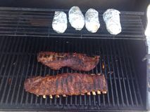 Bbq ribs. Barbecue pork ribs with baked potato Stock Images