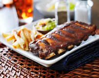 Bbq ribs. With cole slaw and french fries royalty free stock images
