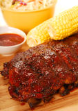 BBQ Ribs with corn on the cob Stock Images