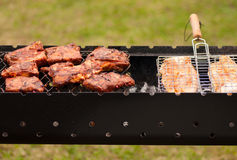 BBQ Ribs and fish  on grill with charcoal Stock Photo