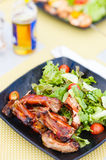 BBQ ribs. And fresh green salad served for lunch Stock Photography