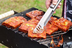 BBQ Ribs on grill with charcoal Royalty Free Stock Image