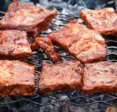 BBQ Ribs on grill with charcoal Royalty Free Stock Images