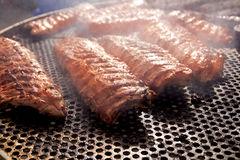 BBQ ribs grilled meat smoke fog barbecue. Food royalty free stock photography