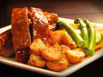 BBQ Ribs with roasted potatoes Stock Photo