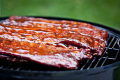 BBQ Ribs. St Louis style BBQ ribs glazed in sauce stock photography