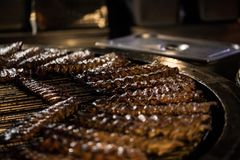 BBQ Roast Marinated Baby Back Pork Ribs. Close-up On Hot Flaming Grill Background