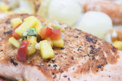 Bbq salmon with mongo sauce. Bbq salmon with mango sauce on a white plate Stock Photography