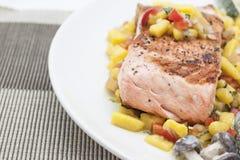 Bbq salmon with mongo sauce. Bbq salmon with mango sauce on a white plate Stock Photo