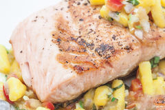 Bbq salmon with mongo sauce. Bbq salmon with mango sauce on a white plate Royalty Free Stock Photography