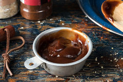 BBQ Sauce. In vintage measuring cup royalty free stock photography