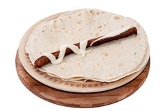 BBQ Sausage with mayonnaise on a Mexican tortilla Stock Photography