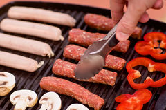 BBQ with sausages, pappers and mushrooms Stock Photo