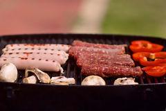 BBQ with sausages, pappers and mushrooms Stock Images