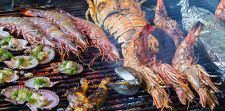 Bbq seafood. Cooked mussel, clam, Tiger Shrimps BBQ seafood Royalty Free Stock Images