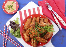 BBQ setting with spicy chicken wings. Stock Image