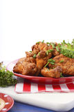 BBQ setting with spicy chicken wings. Stock Images