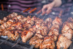 BBQ, shish kebab, grilled meat. Appetizing shish kebab is fried on a skewers outdoor stock photography