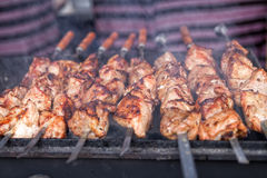 BBQ, shish kebab, grilled meat. Appetizing shish kebab is fried on a skewers outdoor royalty free stock photo