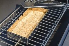 BBQ Smoker Box. Smoker Box - Wood chips inside a metal smoking box on a BBQ. BBQ Time Stock Image