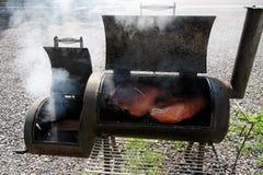 BBQ Smoker Grill. Barbecue smoker with brisket and pork. Pleasant aroma. Horizontal stock image
