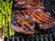BBQ Steak and Asparagus Stock Photography