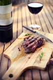 BBQ steak. Barbecue grilled beef steak meat with red wine and kn Royalty Free Stock Images