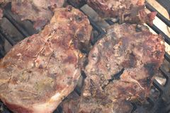 BBQ Steak. Closeup of pork steaks on the BBQ stock photo