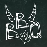 BBQ Steak Concept Lettering with Fire and Bull Horns. Meat Logo.  on a Black Chalkboard Background.. Realistic Royalty Free Stock Image
