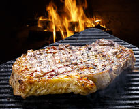 BBQ steak. Grilled steak on background fire Royalty Free Stock Photo