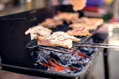 Grilling food on barbecue grill, hands preparing skewers Royalty Free Stock Photo