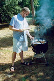 BBQ Time. Original photo of a man grilling outside stock image
