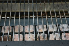 BBQ time. The grate of a gas grill with ceramic stones Stock Images
