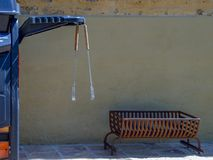 BBQ tongs hanging from a BBQ grill stock photo