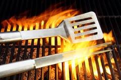 BBQ Utensils and Hot cast iron grate XXXL Stock Photos