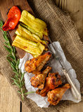 BBQ Wings in sauce with Vegetables on a Wooden Table in a Rustic Royalty Free Stock Image