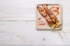 Bbq on wooden plate Stock Photos