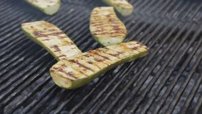 Bbq zucchini on a grill. Barbecue vegetables cooking at the street food festival. Handheld camera stock video footage