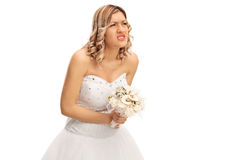 Bbride experiencing pain in her abdomen. Studio shot of a young bride experiencing pain in her abdomen isolated on white background Stock Images